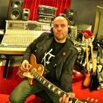 David Myhr (in studio with guitar - big)